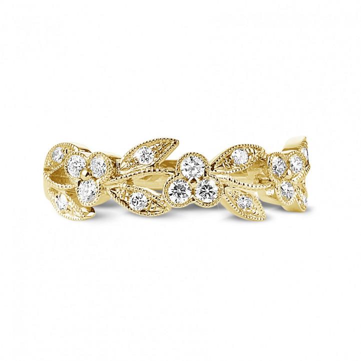 0.32 Karat Memoire Ring mit kleinen Blättern aus Gelbgold mit runden Diamanten