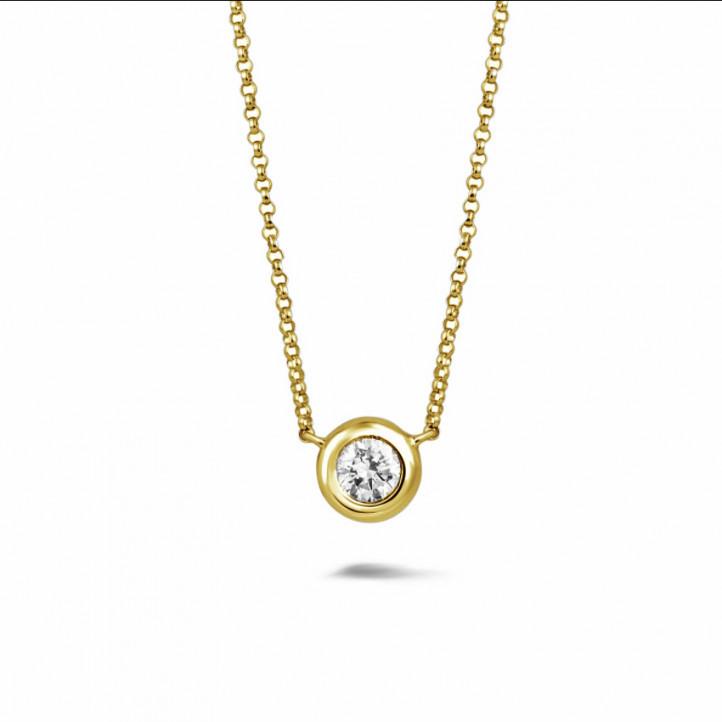 0.70 Karat diamantener Anhänger in Zargenfassung aus Gelbgold