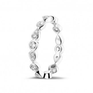 Diamant Memoire Ring aus Platin - 0.50 Karat diamantener Kombination Memoire Ring aus Platin mit birnenförmigem Design