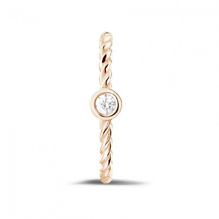 0.07 Karat gedrehter Kombination Ring aus Rotgold mit Diamant