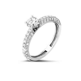 Engagement - 0.50 carat solitaire ring (half set) in platinum with side diamonds