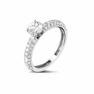 Engagement - 0.70 carat solitaire ring (half set) in platinum with side diamonds