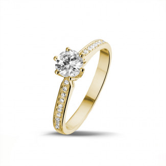 Classics - 0.75 carat solitaire diamond ring in yellow gold with side diamonds