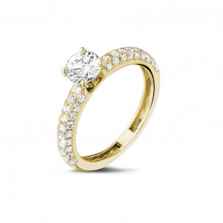 Engagement - 0.70 carat solitaire ring (half set) in yellow gold with side diamonds