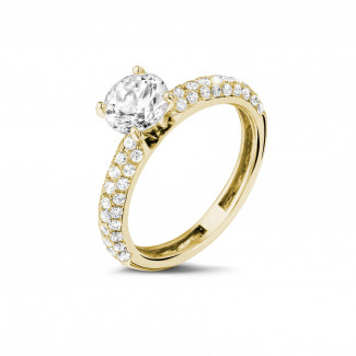 - 1.20 carat solitaire ring (half set) in yellow gold with side diamonds
