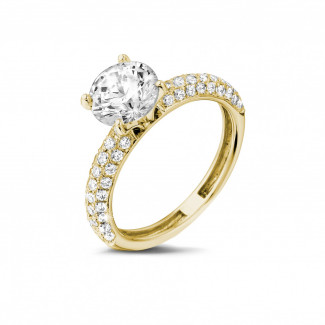 - 1.50 carat solitaire ring (half set) in yellow gold with side diamonds