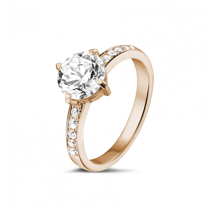 1.50 carat solitaire diamond ring in red gold with side diamonds