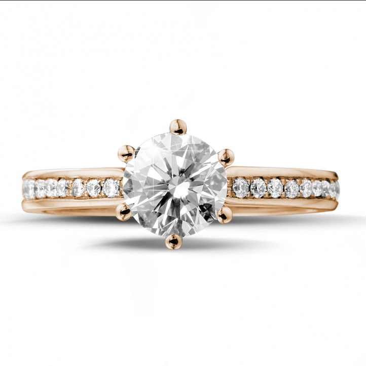 0.90 carat solitaire diamond ring in red gold with side diamonds
