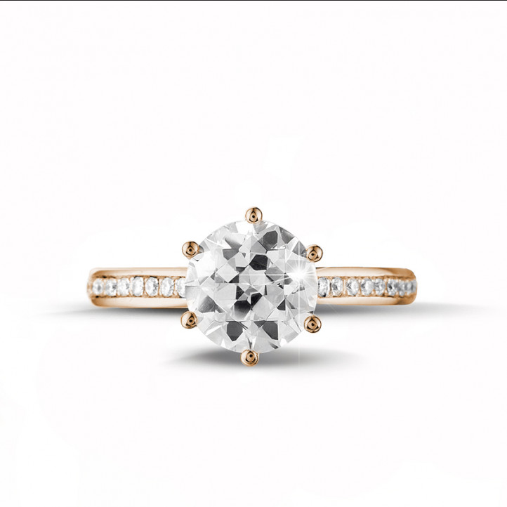 2.00 carat solitaire diamond ring in red gold with side diamonds