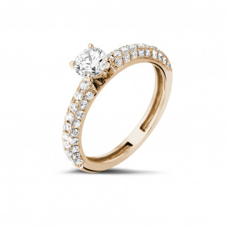 Engagement - 0.70 carat solitaire ring (half set) in red gold with side diamonds
