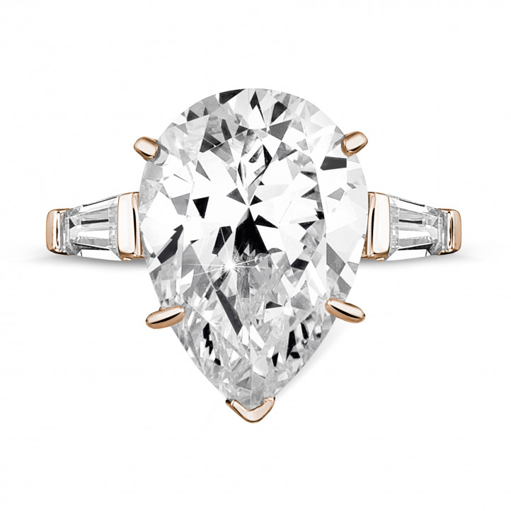 Ring in red gold with pear shaped diamond and taper cut baguette diamonds