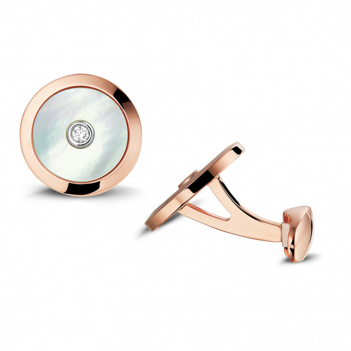 Red golden cufflinks with mother of pearl and a central diamond