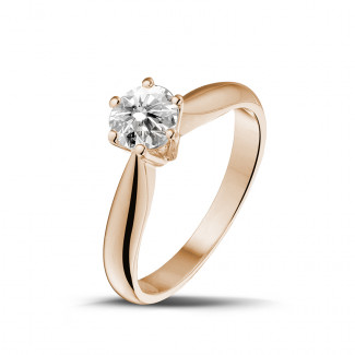 - 0.75 carat solitaire diamond ring in red gold