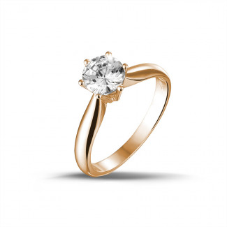 - 0.90 carat solitaire diamond ring in red gold