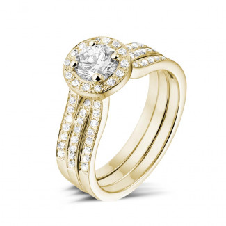 Engagement - 0.70 carat solitaire diamond ring in yellow gold with side diamonds