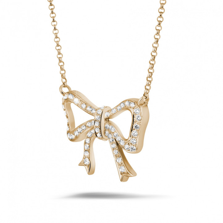 Necklace with diamond bow in red gold