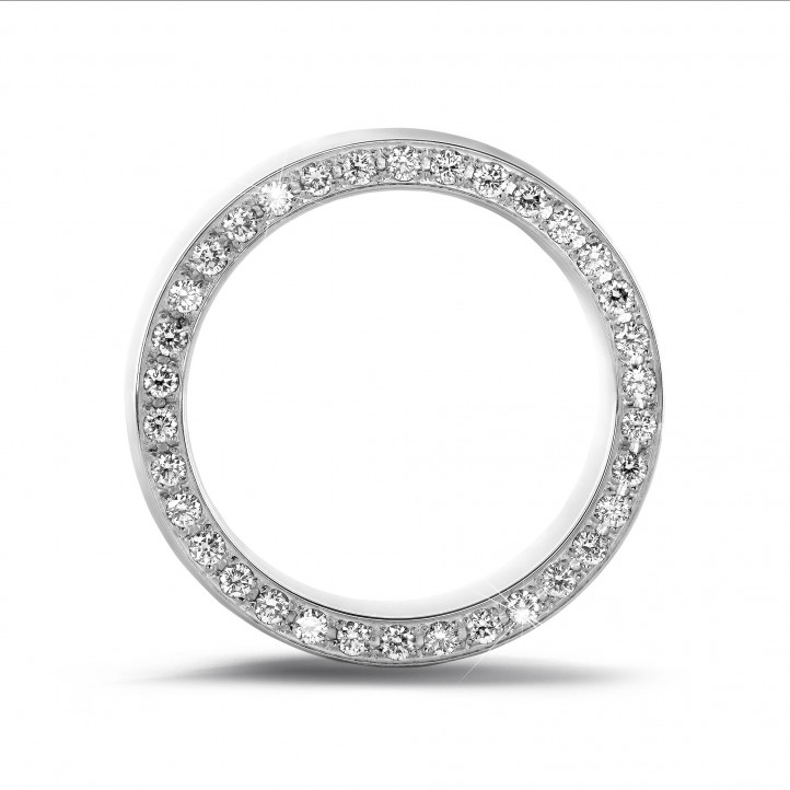 0.70 carat eternity ring in white gold with small round diamonds on the side