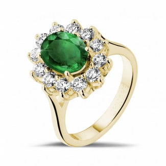 Yellow Gold Diamond Rings - Entourage ring in yellow gold with an oval emerald and round diamonds