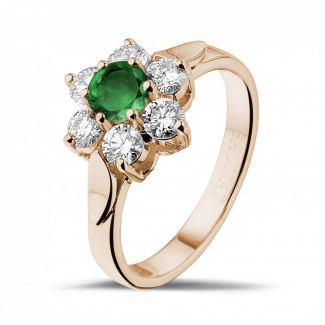 Flower ring in red gold with a round emerald and side diamonds