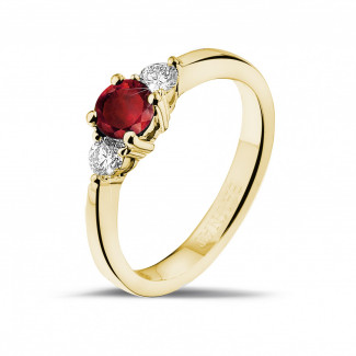 Yellow Gold Diamond Engagement Rings - Trilogy ring in yellow gold with a central ruby and 2 round diamonds