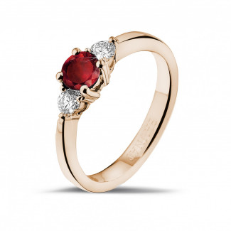 Red Gold Diamond Engagement Rings - Trilogy ring in red gold with a central ruby and 2 round diamonds