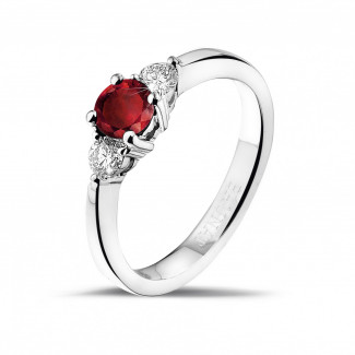 Platinum Diamond Engagement Rings - Trilogy ring in platinum with a central ruby and 2 round diamonds