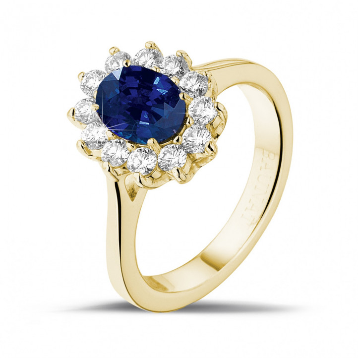 Entourage ring in yellow gold with an oval sapphire and round diamonds
