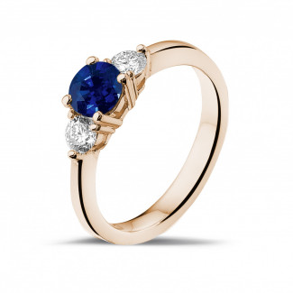 Red Gold Diamond Rings - Trilogy ring in red gold with a central sapphire and 2 round diamonds
