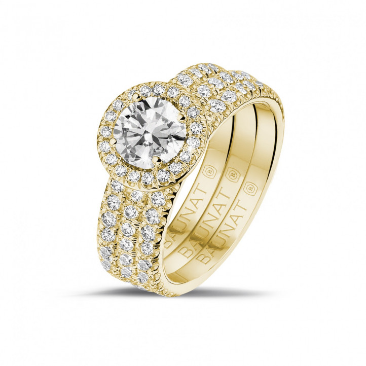 0.70 carat solitaire halo ring in yellow gold with round diamonds