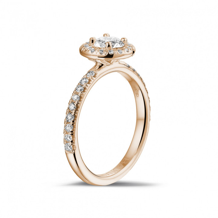 0.50 carat solitaire Halo ring in red gold with round diamonds