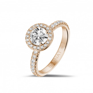 0.70 carat solitaire halo ring in red gold with round diamonds