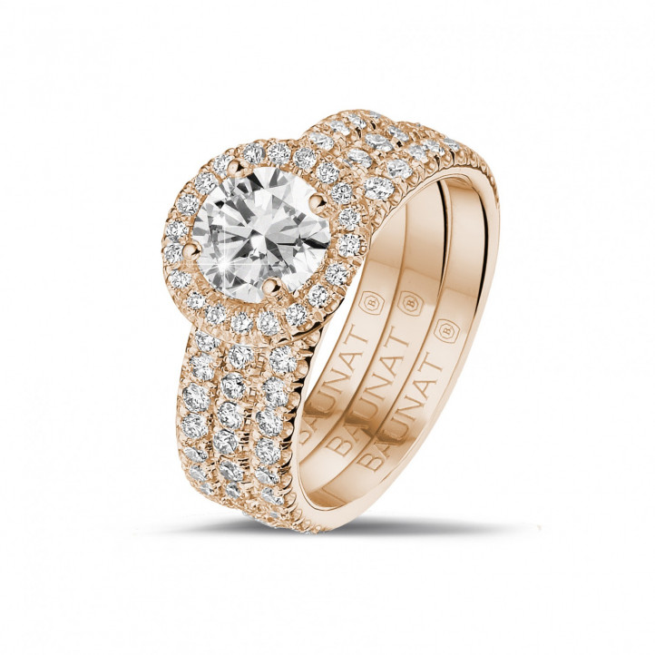 1.00 carat solitaire halo ring in red gold with round diamonds