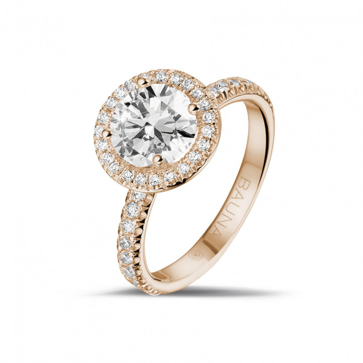 1.50 carat solitaire halo ring in red gold with round diamonds