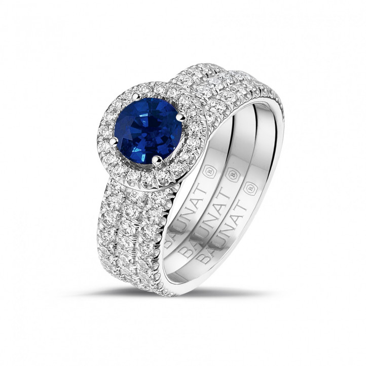 Halo solitaire ring in white gold with a round sapphire and small diamonds