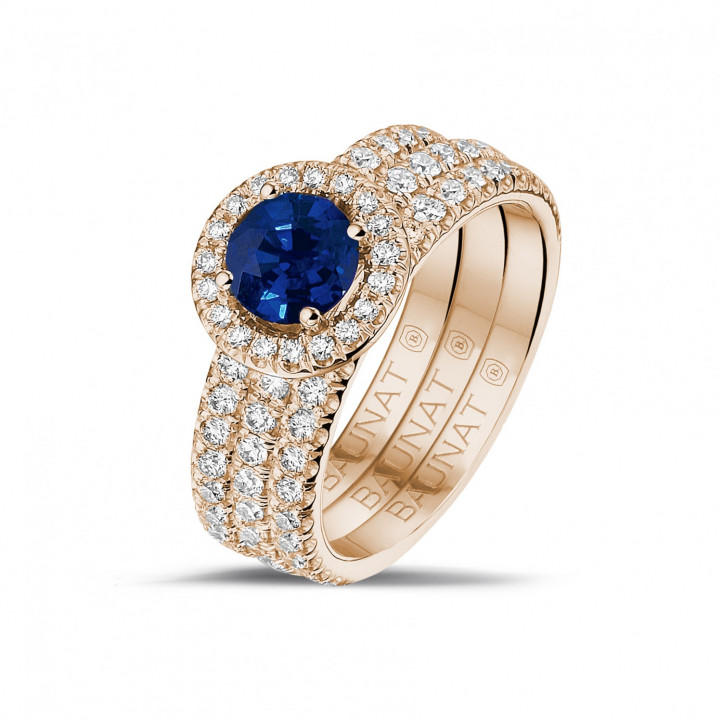 Halo solitaire ring in red gold with a round sapphire and small diamonds