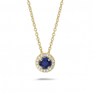 Diamond Pendants - Halo necklace in yellow gold with a central sapphire and round diamonds