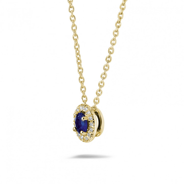Halo necklace in yellow gold with a central sapphire and round diamonds
