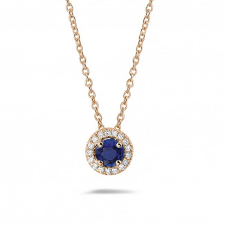 Halo necklace in red gold with a central sapphire and round diamonds