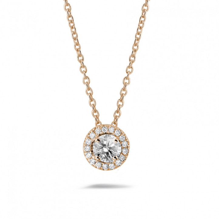 0.50 carat diamond halo necklace in red gold
