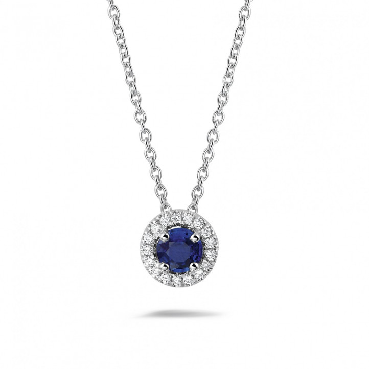 Halo necklace in white gold with a central sapphire and round diamonds