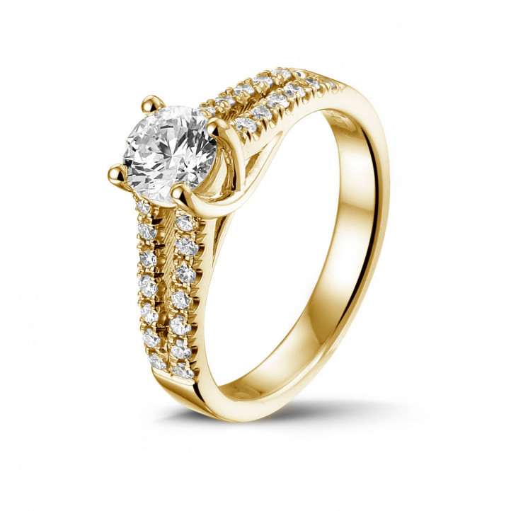 0.70 carat solitaire ring in yellow gold with side diamonds