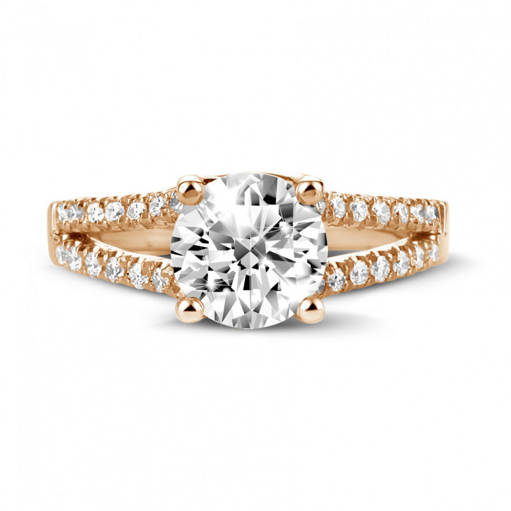 1.50 carat solitaire ring in red gold with side diamonds