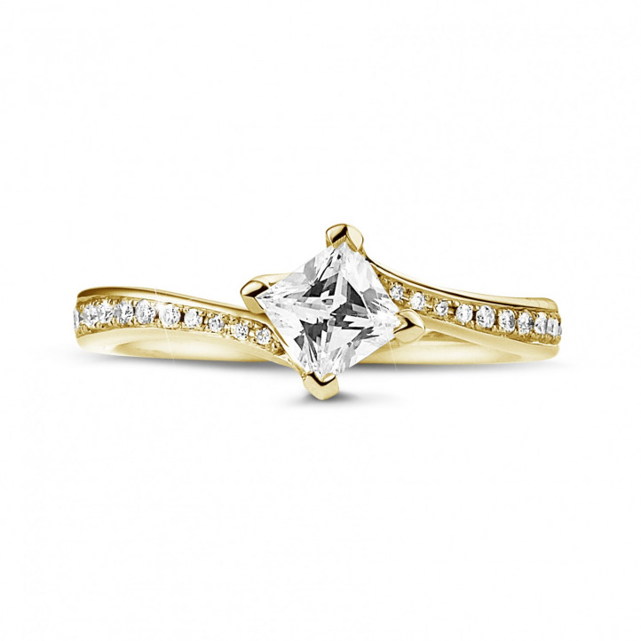 0.50 carat solitaire ring in yellow gold with princess diamond and side diamonds