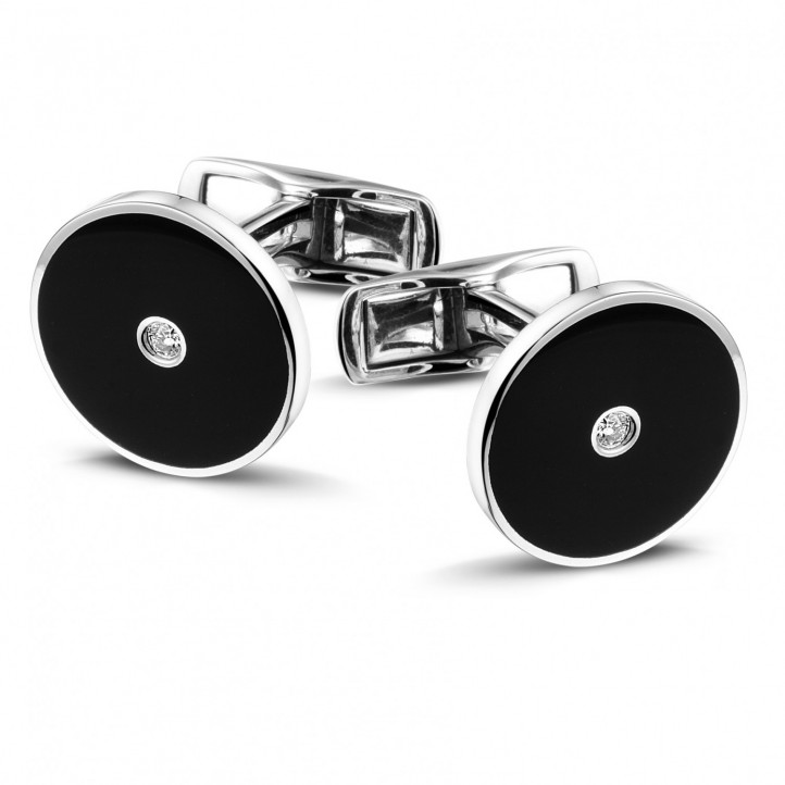 White golden cufflinks with onyx and a central diamond