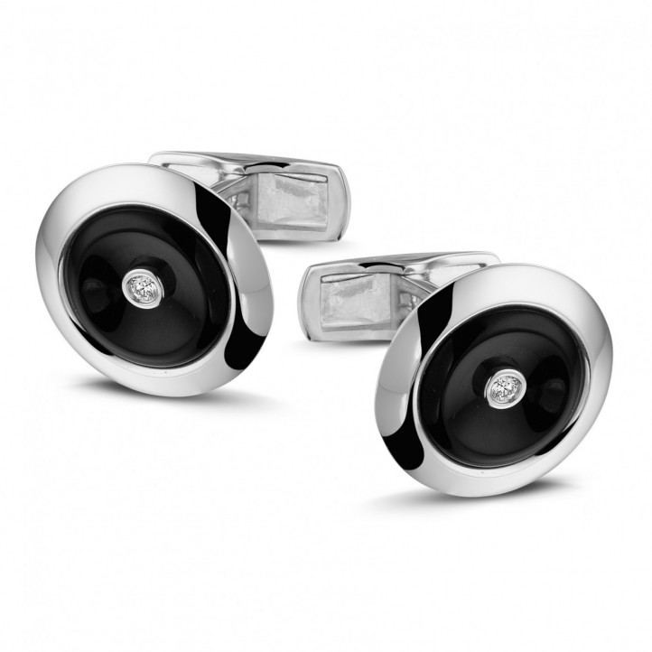 Platinum cufflinks with onyx and a central diamond