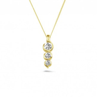 Diamond Pendants - 0.57 carat trilogy diamond pendant in yellow gold