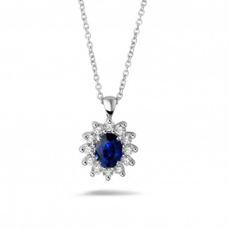 Entourage pendant in white gold with oval sapphire and round diamonds