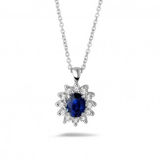 Diamond Pendants - Entourage pendant in white gold with oval sapphire and round diamonds
