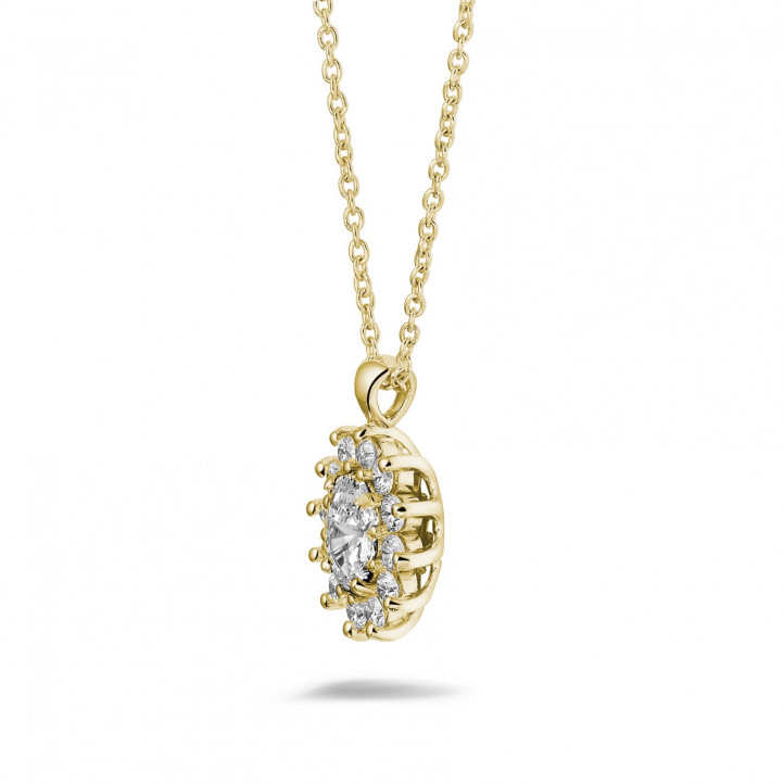 1.85 carat entourage pendant in yellow gold with oval and round diamonds