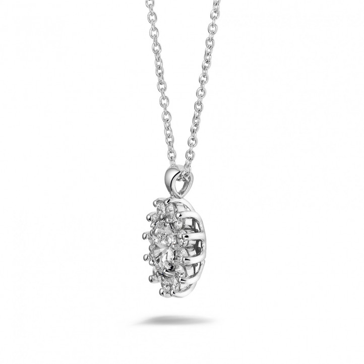 1.85 carat entourage pendant in platinum with oval and round diamonds